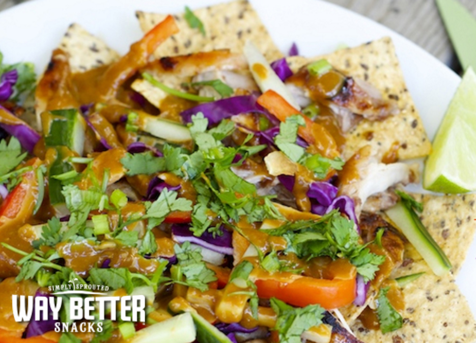 Thai touchdown nachos for the win! These nachos with a kick build a tasty base from Simply Spicy Sriracha chips.